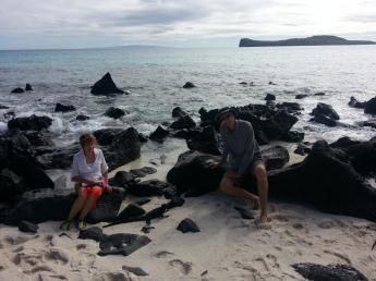 Laurie & Jim enjoying some Marine Iguana time